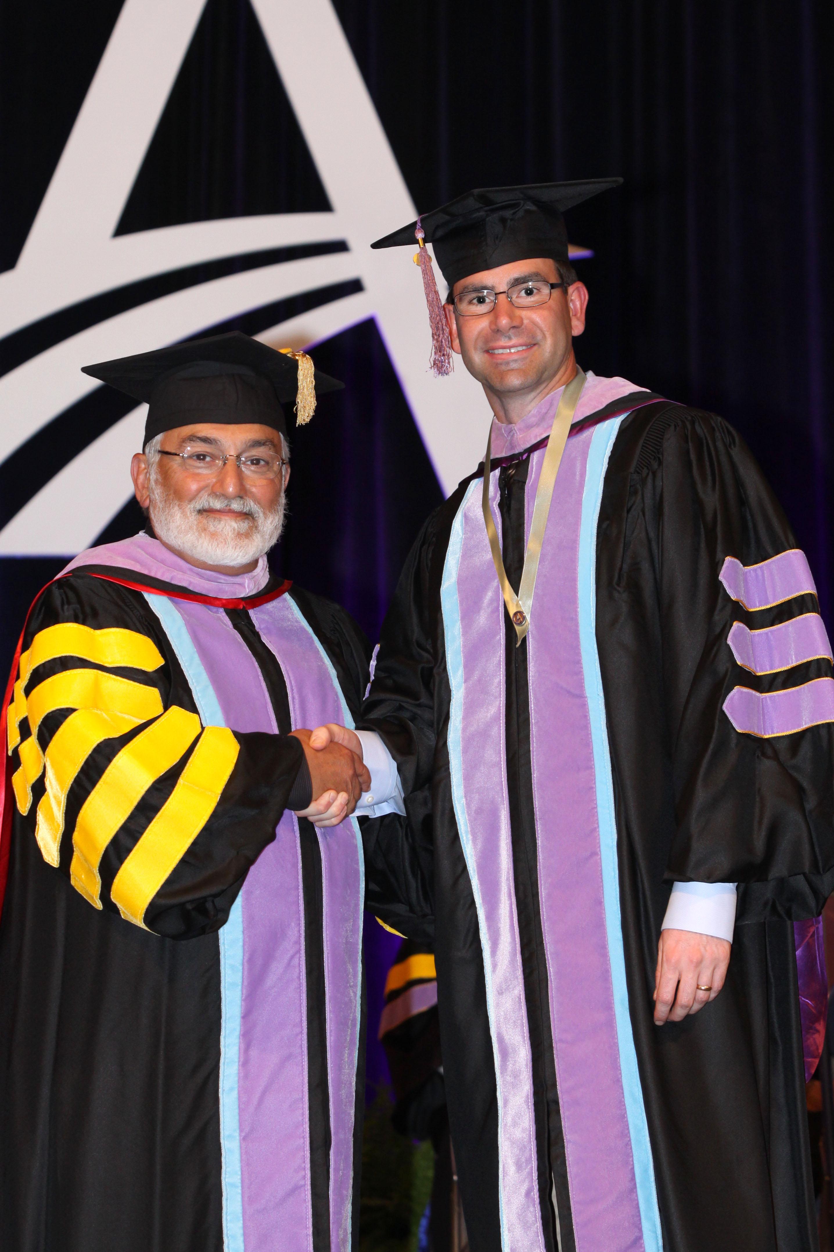 Dr. Carl Youngquist receiving the Fellowship award.